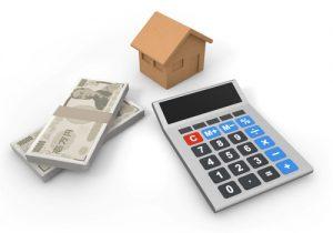 電卓と家とお金の絵