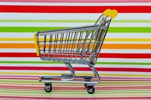 カラフルな背景のショッピングカート